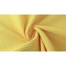 Vaflinis medvilninis audinys geltonas